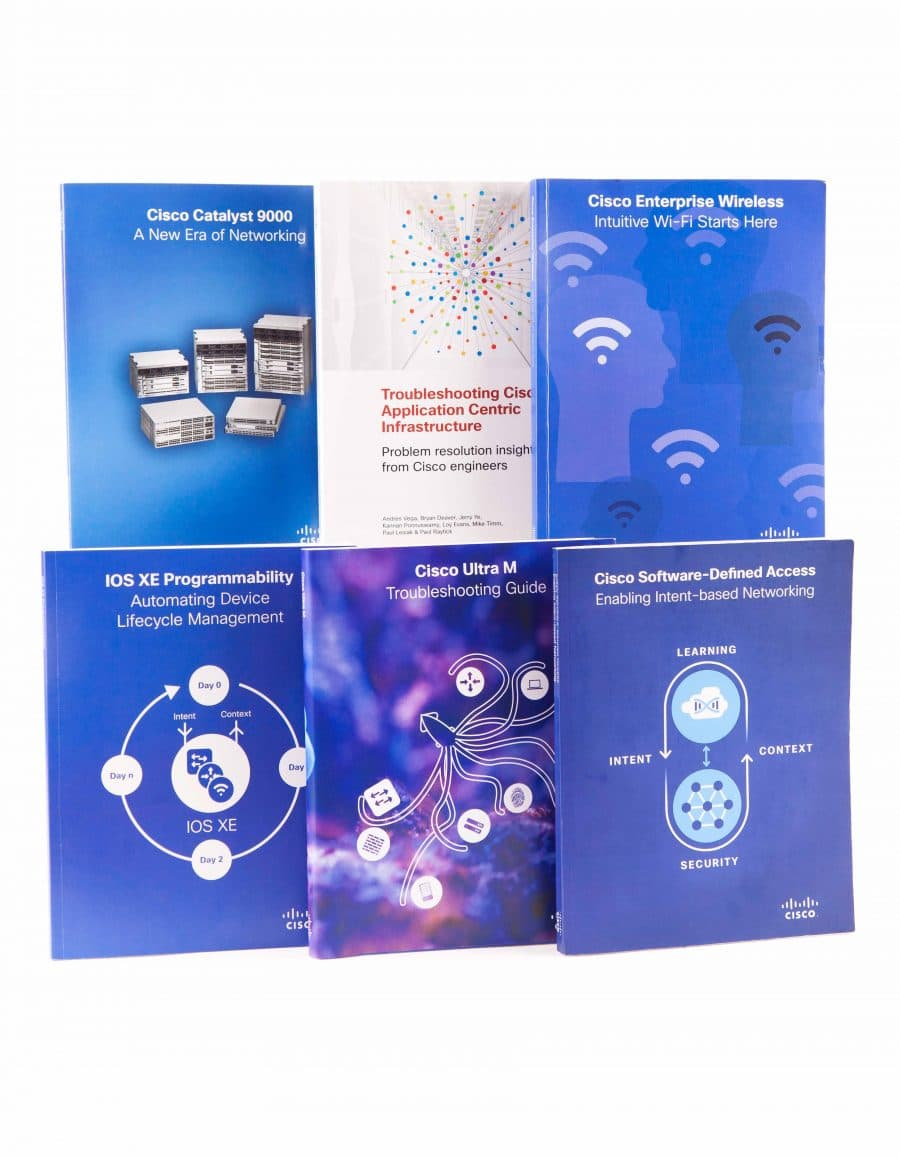 Six books produced for Cisco displayed in a line