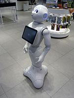A friendly robot with a screen on the chest in a department store
