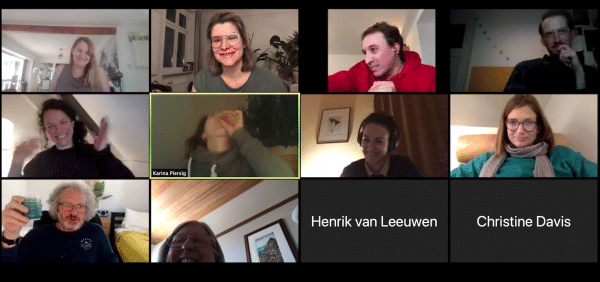 An online meeting with a dozen people laughing
