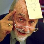 Arthur Fry, inventor of the Post-it Note, with one on his forehead bearing a with a picture of a lightbulb
